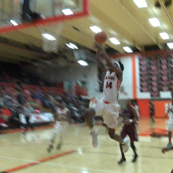 Manual's Romon Douglas-Watkins dunks
