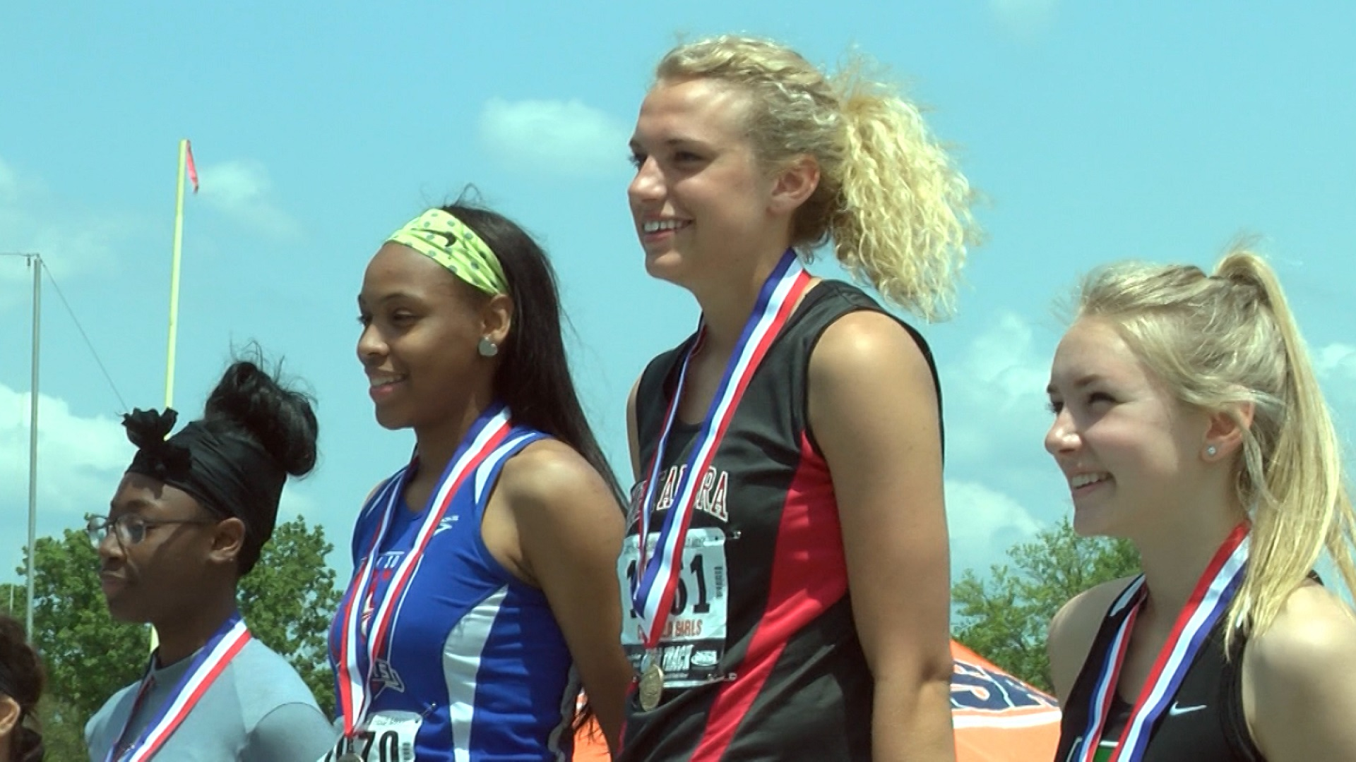 Gillian Urycki high jump medal