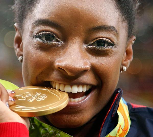 simone-biles_biting-medal_rio-olympics_ap_20160812015512-159532