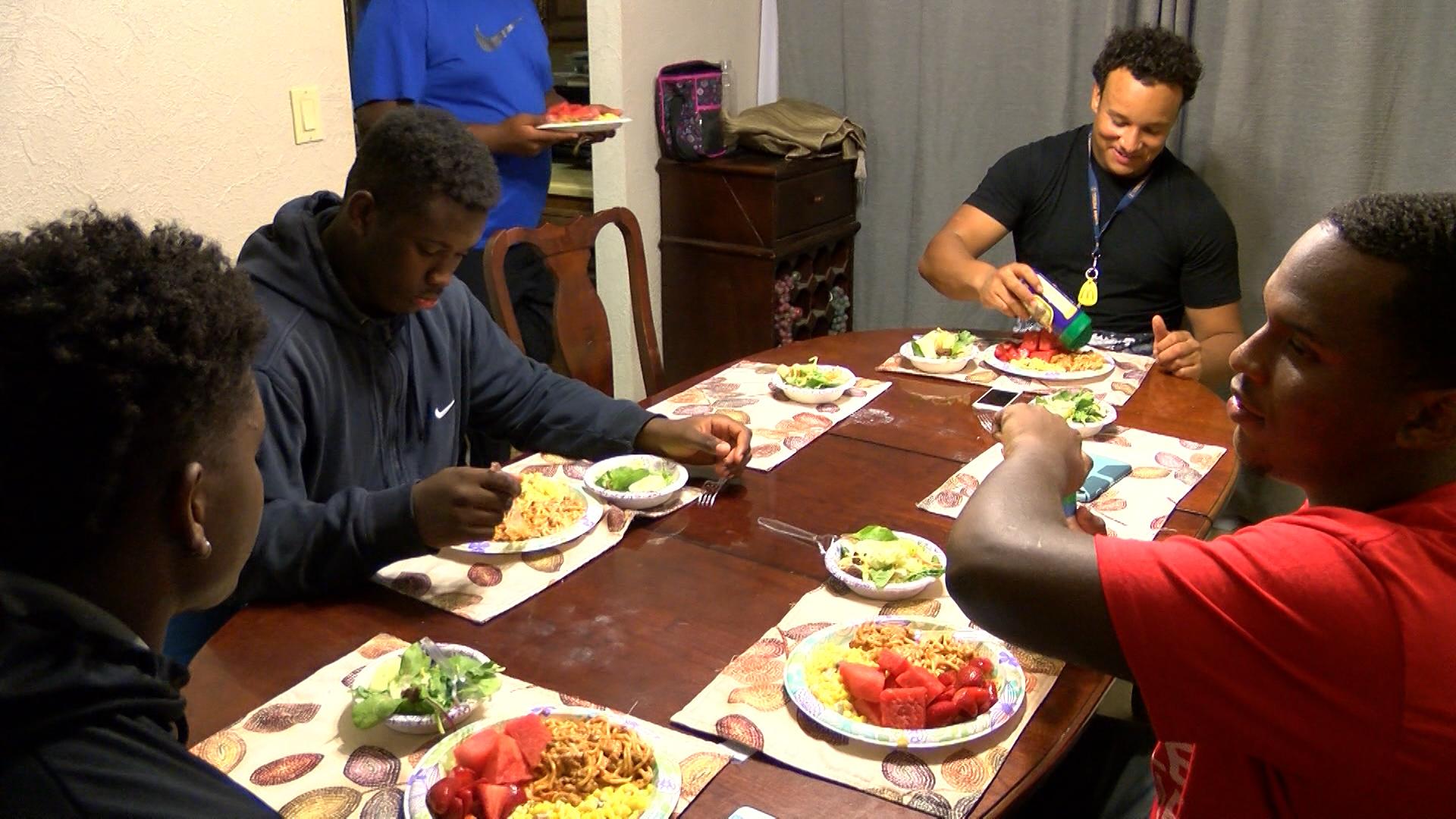 Central linemen eat (at table)_1473725071517.jpg