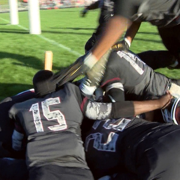 Peoria High dogpile after beating Danville