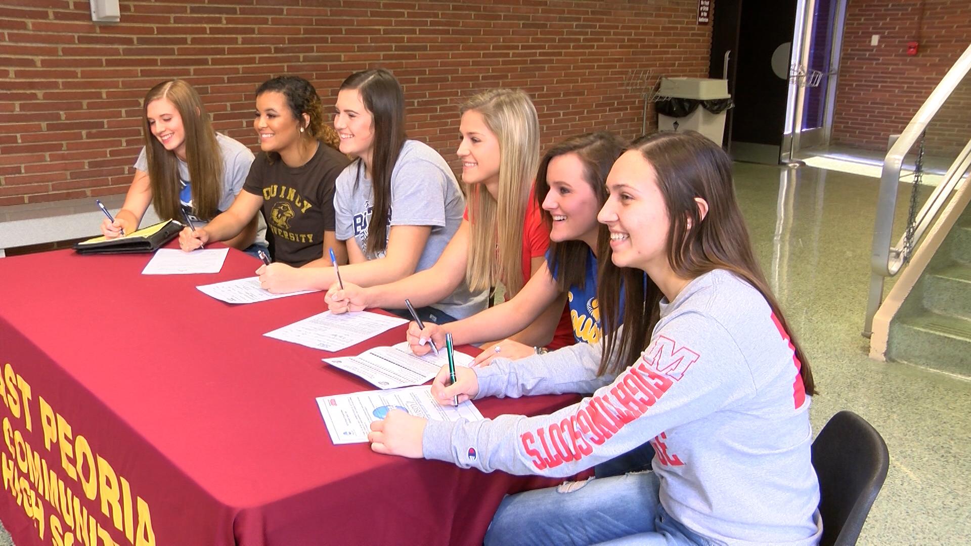 East Peoria softball girls at table_1478830493453.jpg