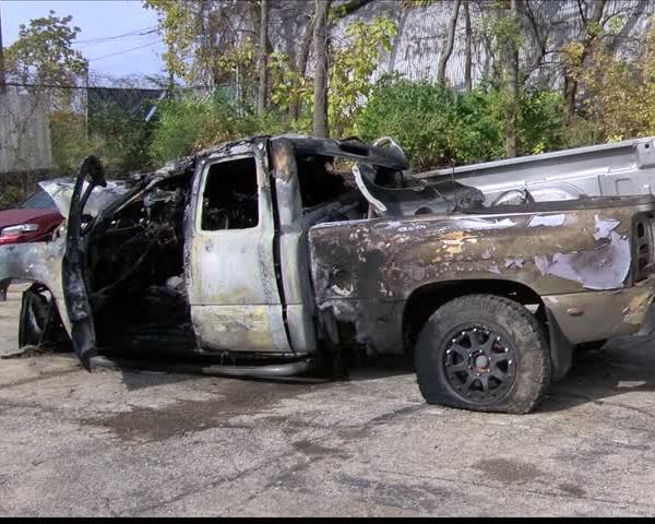 Police officers save driver from fiery crash