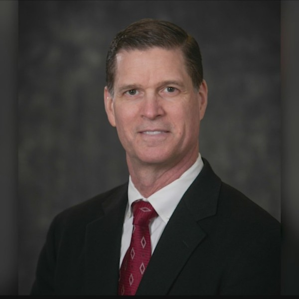 Brian Elsasser reflects on life, service of Peoria Co. Board member Greg Adamson