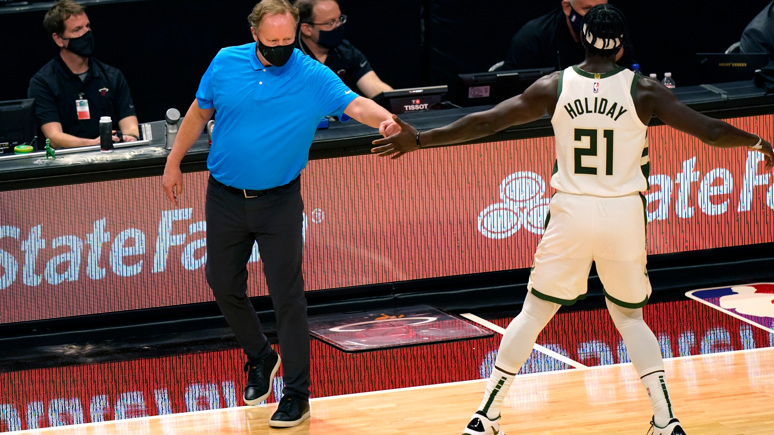 Mike Budenholzer, Jrue Holiday